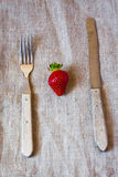 Old cutlery and strawberry Stock Images