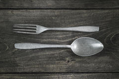 Old cutlery on wooden table Stock Photos