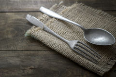 Old cutlery on wooden table Royalty Free Stock Image