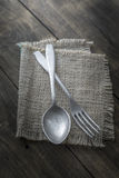 Old cutlery on wooden table Stock Images