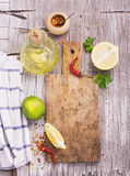 Old cutting board with a spicy red dried chilli Stock Image