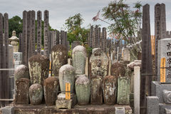 Old cylindrical tombstones set together on Japanese cemetery. Kyoto, Japan - September 15, 2016: Adjacent to the Shinnyo-do Buddhist Temple is a large cemetery Royalty Free Stock Photo