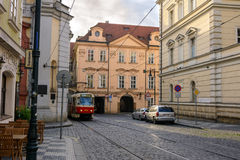 Old Czech tram on a deserted street in the early morning in Prague Stock Images