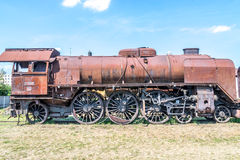 Old Czechoslovakian CSD steam engine on graveyard, rusty Stock Image