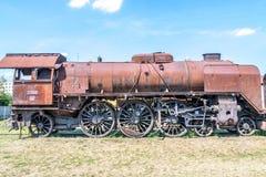Old Czechoslovakian CSD steam engine on graveyard, rusty Stock Image