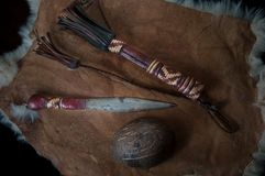 Old dagger, beautiful ritual knife, with a wooden scabbard decorated with leather. On leather royalty free stock images