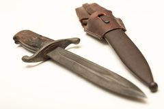 Old dagger with scarbard laying on a white background stock images