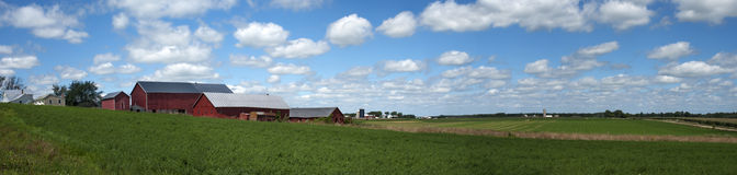 Old Dairy Farm Barn Sky Clouds Panorama Banner. Scenic panoramic of old red barn and farm scene out in dairy country of Wisconsin, USA. Soybeans are growing in stock photo