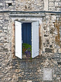 Old Dalmatian house facade with window Stock Photo
