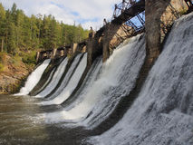 Old dam on the river on a background of mountains and woods Stock Photography