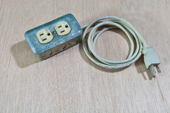 Old damage Extension cord Stock Photo