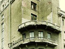 Old damaged balcony on the building with peeling stucco. St Petersburg, Russia Royalty Free Stock Images