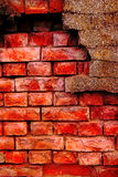 Old and damaged brick wall. With plaster Royalty Free Stock Photography