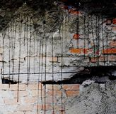 Old and damaged brick wall with black dripping. Design element. Stock Images