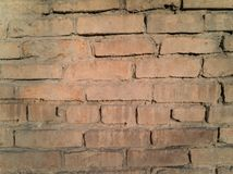 Old damaged brick wall stock photo