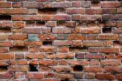 Old damaged brick wall with holes Royalty Free Stock Images