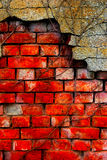 Old damaged brick wall and plaster. Old and damaged brick wall and plaster Stock Photography