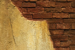 Old damaged brick wall with plaster Stock Image