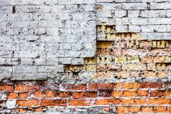 The old damaged brick wall with rich texture Stock Photos