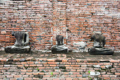 Old damaged Buddha in Ayuthaya Thailaand. Old damaged Buddha in Thai contemporary temple in Ayuthaya, Thailand Royalty Free Stock Photo
