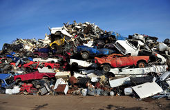 Old damaged cars on the junkyard waiting for recycling. Royalty Free Stock Photo