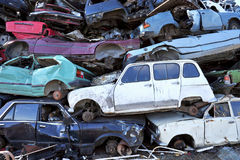 Old damaged cars on the junkyard waiting for recycling. Stock Photography