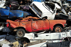 Old damaged cars on the junkyard waiting for recycling. Royalty Free Stock Image