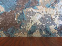 Old damaged color grunge wall and wooden table. Royalty Free Stock Photo