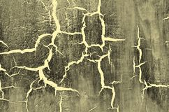 Old Damaged Cracked Paint Wall, Grunge Background, grey and yellow color Royalty Free Stock Photography