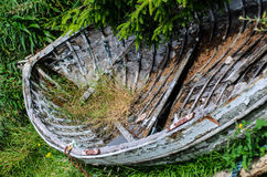 Old and damaged fish boat on shore Royalty Free Stock Photo