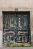 Old damaged front door in Paris, France Stock Photography