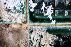 The old and damaged glass bricks surface Stock Photography