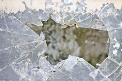 Old damaged glass reinforced with wire mesh Royalty Free Stock Images