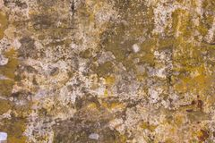 Old damaged gray concrete wall with stains of yellow, red and black paint. rough surface texture. A old damaged gray concrete wall with stains of yellow, red and royalty free stock photography