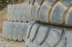 Old and damaged heavy truck tires Stock Images