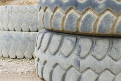 Old and damaged heavy truck tyres Stock Photo