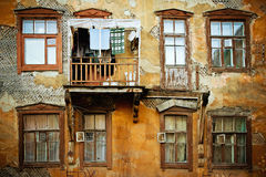 Old damaged house with windows Stock Photography