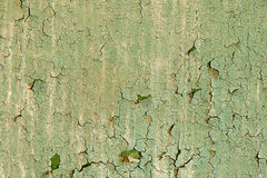 Old damaged paint on a wall. Old damaged paint on a concrete wall texture Royalty Free Stock Image