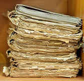 Old and damaged paper dossiers. On heap Royalty Free Stock Photo