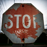 Old Damaged and Peeling Stop Sign Royalty Free Stock Photos