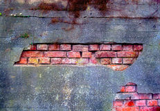 Old and damaged plaster on a brick wall. Old and damaged plaster on the brick wall Stock Image