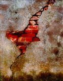 Old damaged plaster on brick wall. Old damaged plaster on a brick wall Stock Photography