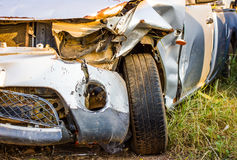 Old damaged rusty car wreck  in the grass Stock Photos