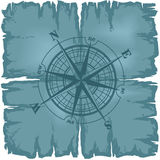 Old damaged sheet of paper with compass rose. Stock Images
