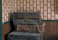 Old damaged suitcases. Pile of old scratched weathered suitcases Stock Photo