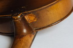 Old damaged violin Royalty Free Stock Photo