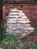 Old damaged wall with bricks Stock Photo