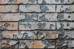 Old damaged wall texture with bricks. Stock Image
