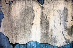 Old damaged whitewash on the concrete wall with rich texture Stock Photo