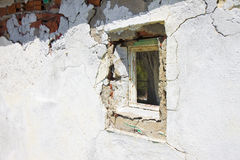 Old damaged window in a plaster wall Royalty Free Stock Images